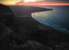 Voyages : Europe Coucher de soleil sur la plage de Famara, Lanzarote, Canaries